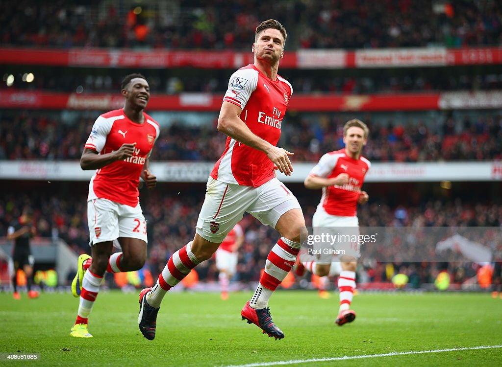 Olivier Giroud of Arsenal celebrates with Danny Welbeck of Arsenal after scoring his team's fourth goal during the Barclays Premier League match between Arsenal and Liverpool at Emirates Stadium on April 4, 2015 in London, England.