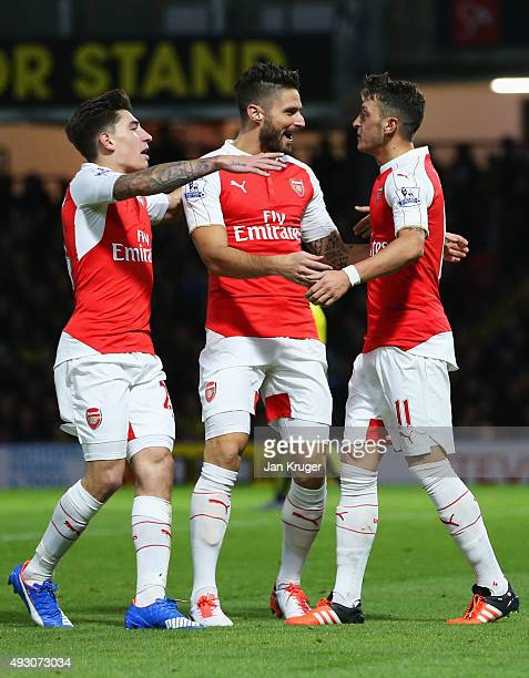 Olivier Giroud of Arsenal celebrates with Hector Bellerin and Mesut Oezil as he scores their second goal during the Barclays Premier League match...