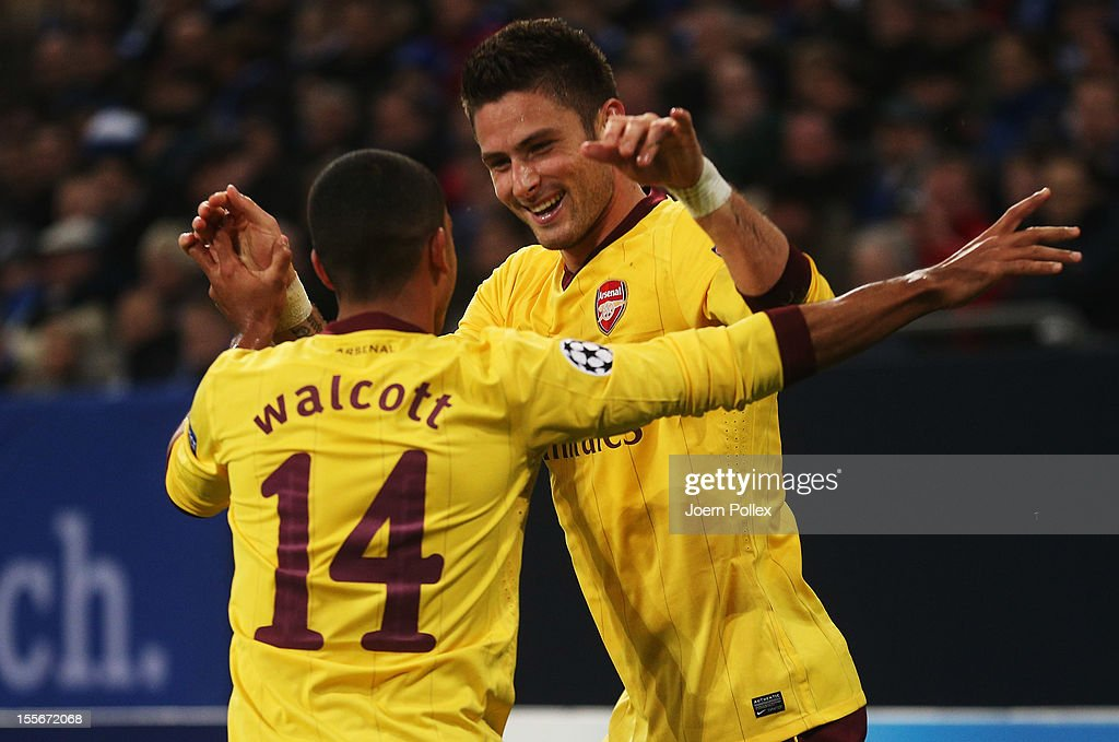 Olivier Giroud (R) of Arsenal celebrates with his team mate Theo Walcott after scoring his team's second goal during the UEFA Champions League group B match between FC Schalke 04 and Arsenal FC at Veltins-Arena on November 6, 2012 in Gelsenkirchen, Germany.
