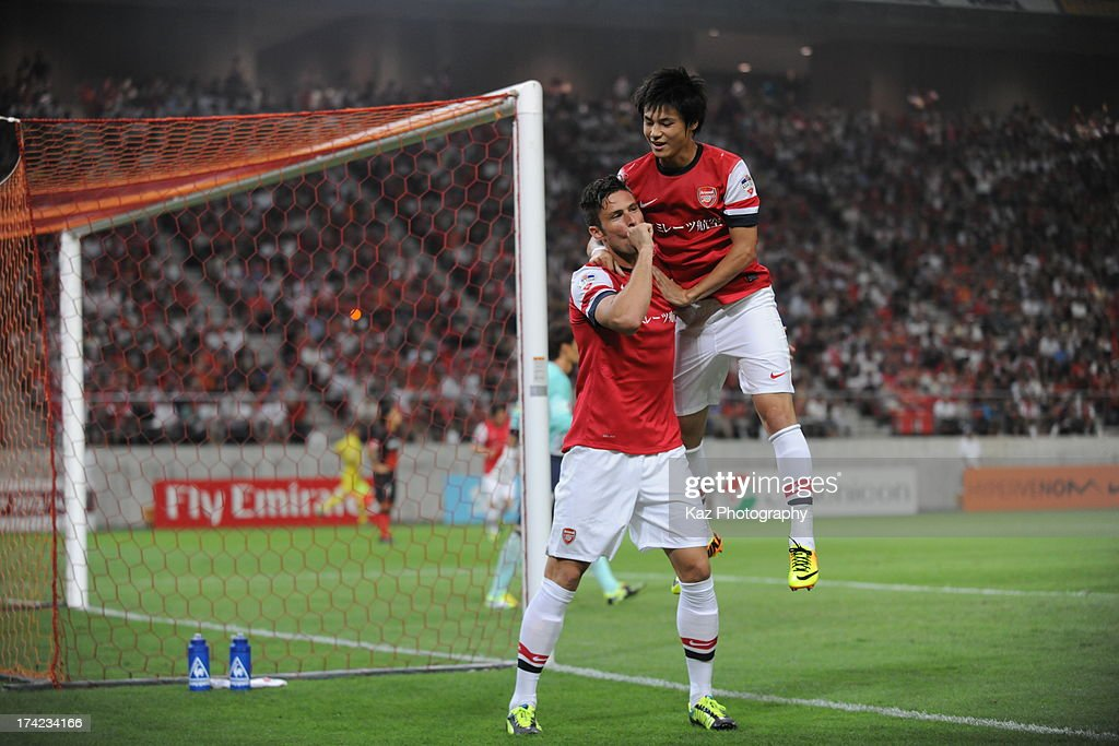 Olivier Giroud of Arsenal celebrates with Ryo Miyaichi of Arsenal after his opener during the preseason friendly match between Nagoya Grampus and...
