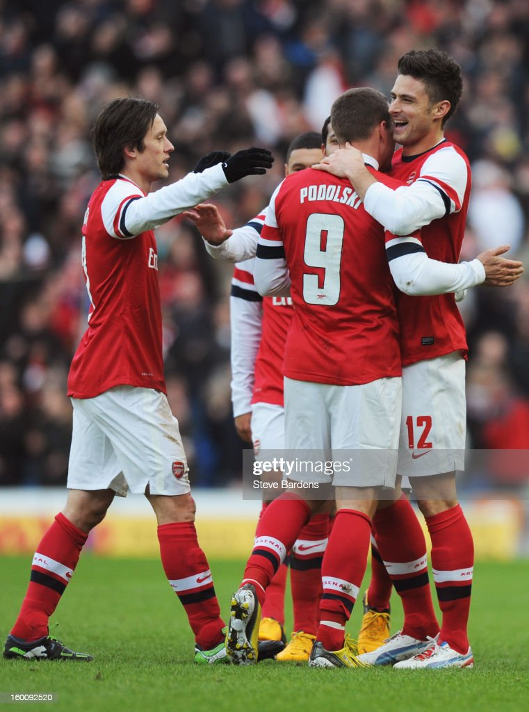 Olivier Giroud of Arsenal (12) celebrates with team mates as he scores their first goal during the FA Cup with Budweiser Fourth Round match between Brighton & Hove Albion and Arsenal at Amex Stadium on January 26, 2013 in Brighton, England.