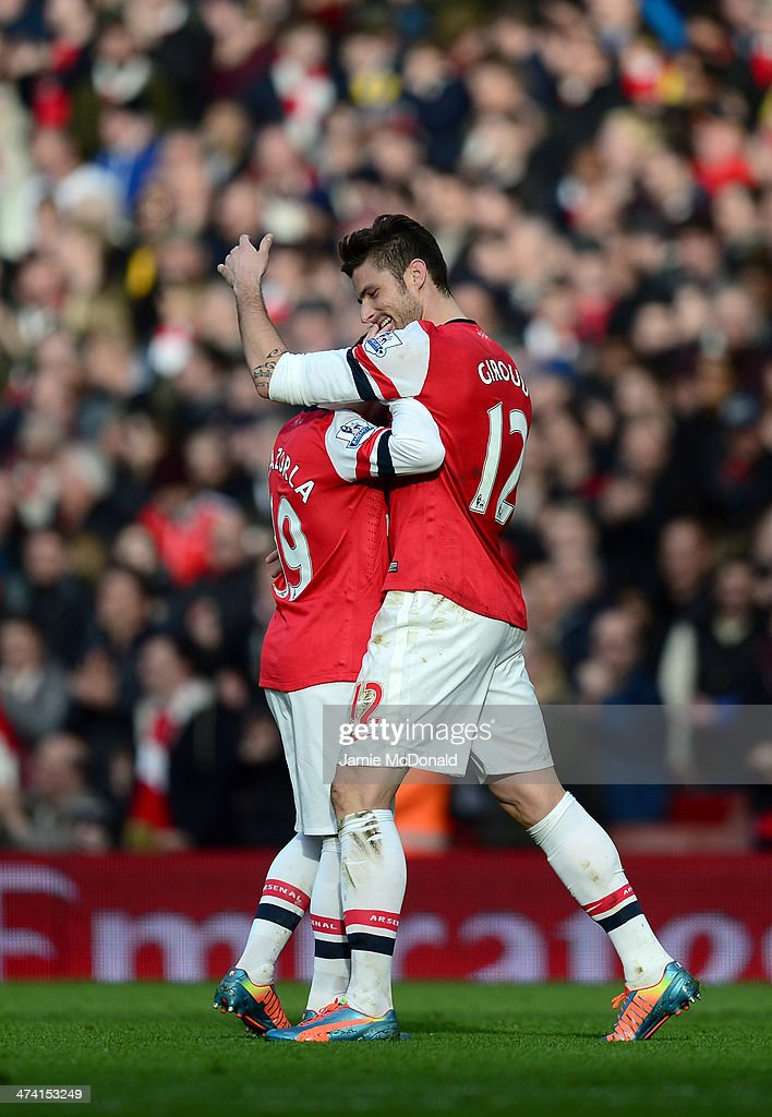 <a gi-track='captionPersonalityLinkClicked' href=/galleries/search?phrase=Olivier+Giroud&family=editorial&specificpeople=5678034 ng-click='$event.stopPropagation()'>Olivier Giroud</a> of Arsenal (R) celebrates with team-mate <a gi-track='captionPersonalityLinkClicked' href=/galleries/search?phrase=Santi+Cazorla&family=editorial&specificpeople=709830 ng-click='$event.stopPropagation()'>Santi Cazorla</a> of Arsenal after scoring the second goal during the Barclays Premier League match between Arsenal and Sunderland at Emirates Stadium on February 22, 2014 in London, England.