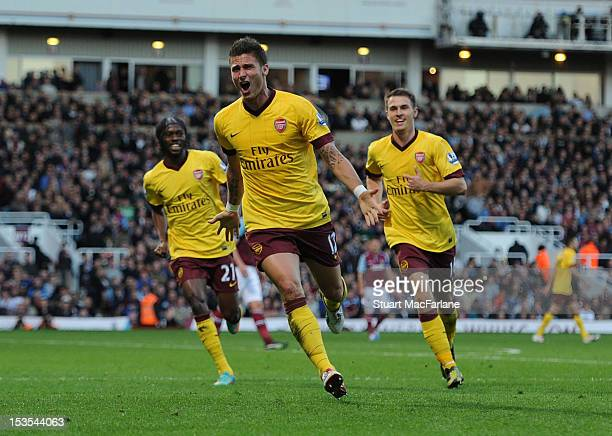 Olivier Giroud of Arsenal celebrates with teammates Gervinho and Aaron Ramsey after scoring their team's first goal during the Barclays Premier...