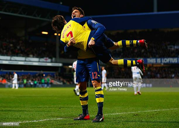 Olivier Giroud of Arsenal celebrates with Tomas Rosicky as he scores their first goal during the Barclays Premier League match between Queens Park...