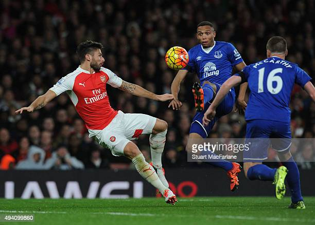 Olivier Giroud of Arsenal challenged by Brendan Galloway of Everton during the Barclays Premier League match between Arsenal and Everton at Emirates...