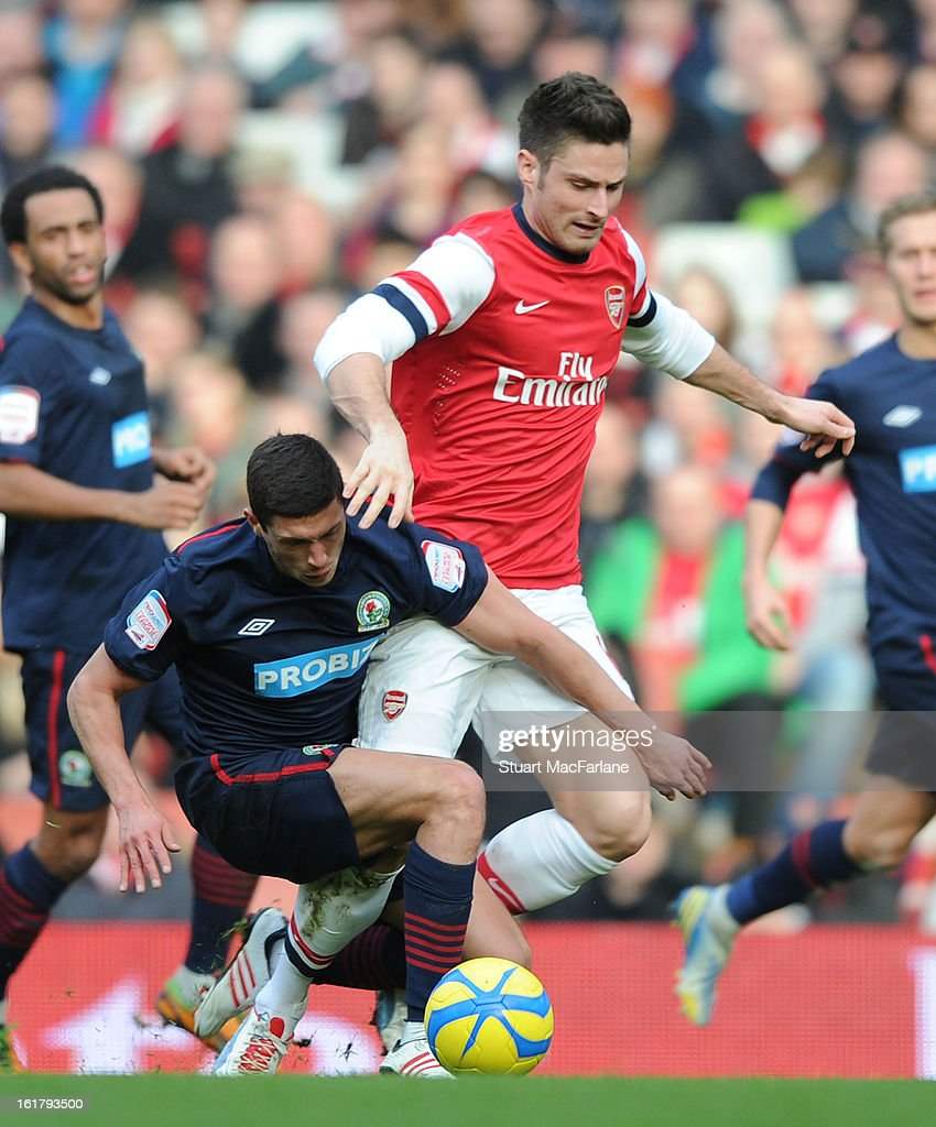Olivier Giroud of Arsenal challenged by Jason Lowe of Blackburn during the FA Cup Fifth Round match between Arsenal and Blackburn Rovers at the Emirates Stadium on February 16, 2013 in London, England.