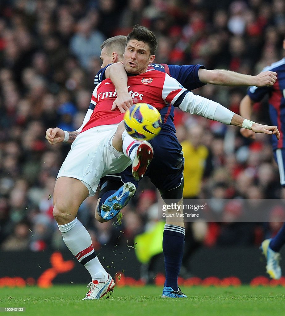 Olivier Giroud of Arsenal challenged by Ryan Shawcross of Stoke during the Barclays Premier League match between Arsenal and Stoke City at Emirates Stadium on February 02, 2013 in London, England.