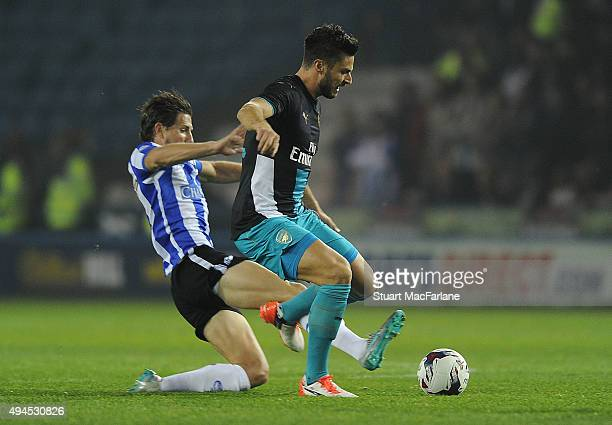 Olivier Giroud of Arsenal challenged by Sam Hutchinson of Sheffield Wednesday during the Capital One Cup Fourth Round match between Sheffield...
