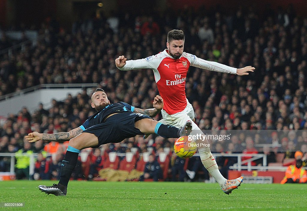 Olivier Giroud of Arsenal challenges Nicolas Otamendi of Man City during the Barclays Premier League match between Arsenal and Manchester City at Emirates Stadium on December 21, 2015 in London, England.
