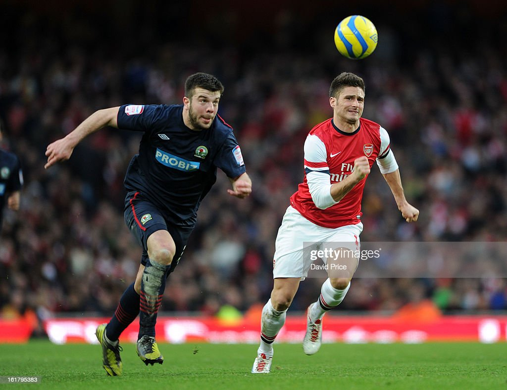 Olivier Giroud of Arsenal chases the ball with Grant Hanley of Blackburn during the FA Cup Fifth Round match between Arsenal and Blackburn Rovers at the Emirates Stadium on February 16, 2013 in London, England.