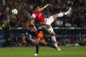 Olivier Giroud of Arsenal clashes with Hilton of Montpellier during the UEFA Champions League match between Montpellier Herault SC and Arsenal at...