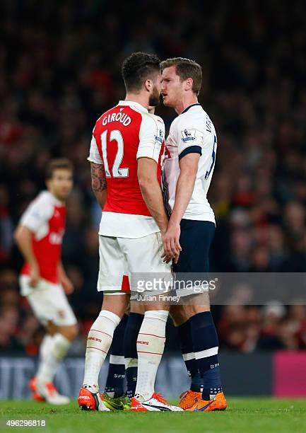 Olivier Giroud of Arsenal clashes with Jan Vertonghen of Spurs during the Barclays Premier League match between Arsenal and Tottenham Hotspur at the...