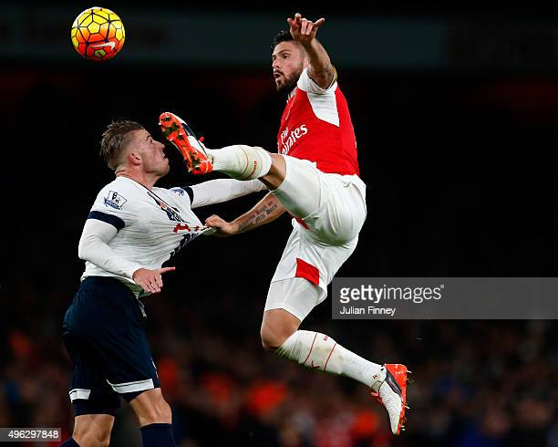 Olivier Giroud of Arsenal climbs above Toby Alderweireld of Spurs to win the ball during the Barclays Premier League match between Arsenal and...