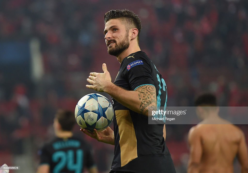 <a gi-track='captionPersonalityLinkClicked' href=/galleries/search?phrase=Olivier+Giroud&family=editorial&specificpeople=5678034 ng-click='$event.stopPropagation()'>Olivier Giroud</a> of Arsenal collects the match ball as he celebrates at the end of Arsenal's win in the UEFA Champions League Group F match between Olympiacos FC and Arsenal FC at Karaiskakis Stadium on December 9, 2015 in Piraeus, Greece.
