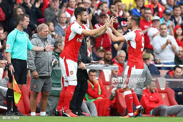 Olivier Giroud of Arsenal comes on for Lucas Perez of Arsenal during the Premier League match between Arsenal and Southampton at Emirates Stadium on...