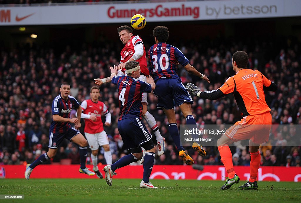 Olivier Giroud of Arsenal competes for the ball against Robert Huth and Ryan Shotton of Stoke City during the Barclays Premier League match between Arsenal and Stoke City at Emirates Stadium on February 2, 2013 in London, England.