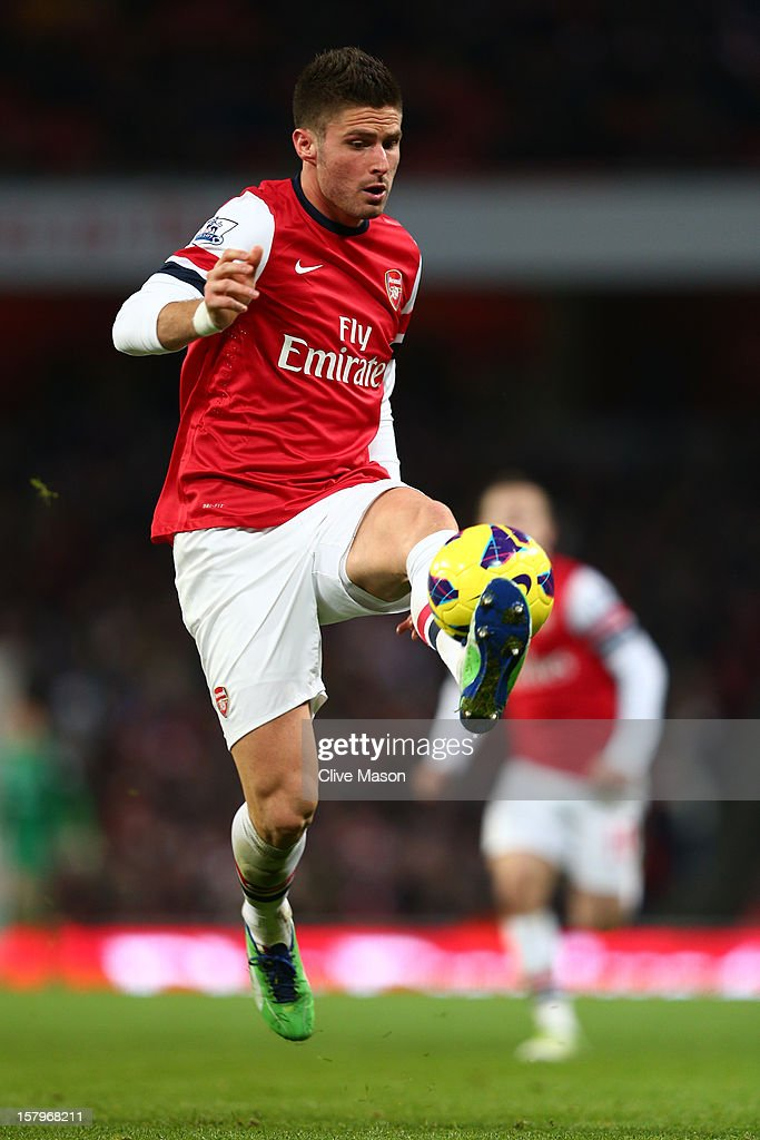 Olivier Giroud of Arsenal controls the ball during the Barclays Premier League match between Arsenal and West Bromwich Albion at Emirates Stadium on December 8, 2012 in London, England.