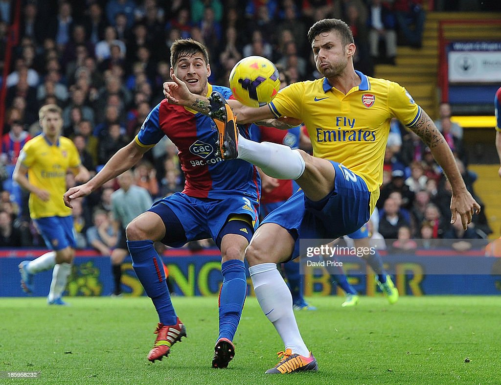 <a gi-track='captionPersonalityLinkClicked' href=/galleries/search?phrase=Olivier+Giroud&family=editorial&specificpeople=5678034 ng-click='$event.stopPropagation()'>Olivier Giroud</a> of Arsenal controls the ball under pressure from Joel Ward of Palace during the match between Crystal Palace and Arsenal at Selhurst Park on October 26, 2013 in London, England.