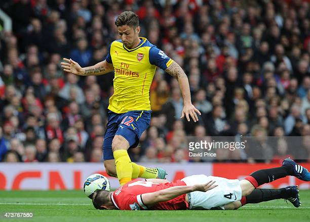 Olivier Giroud of Arsenal controls the ball under pressure from Phil Jones of Manchester United during the match between Manchester United and...