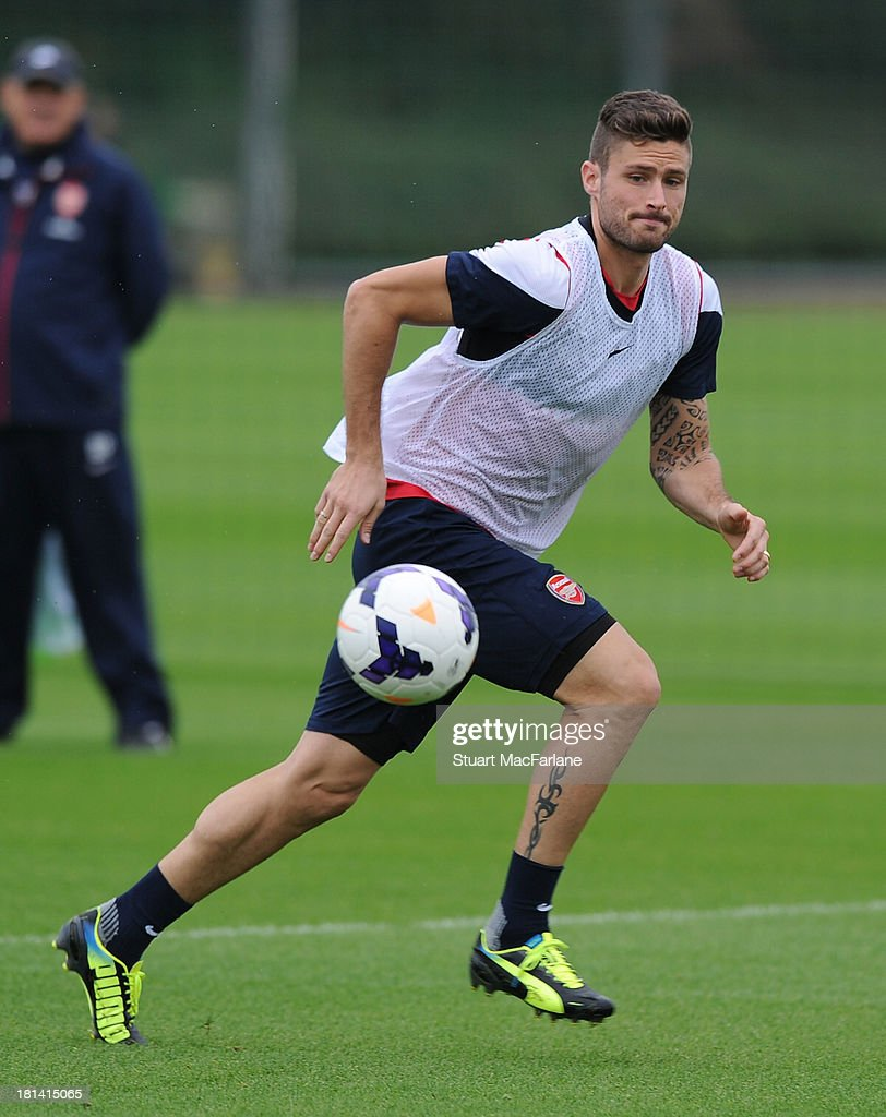 <a gi-track='captionPersonalityLinkClicked' href=/galleries/search?phrase=Olivier+Giroud&family=editorial&specificpeople=5678034 ng-click='$event.stopPropagation()'>Olivier Giroud</a> of Arsenal during a training session at London Colney on September 21, 2013 in St Albans, England.