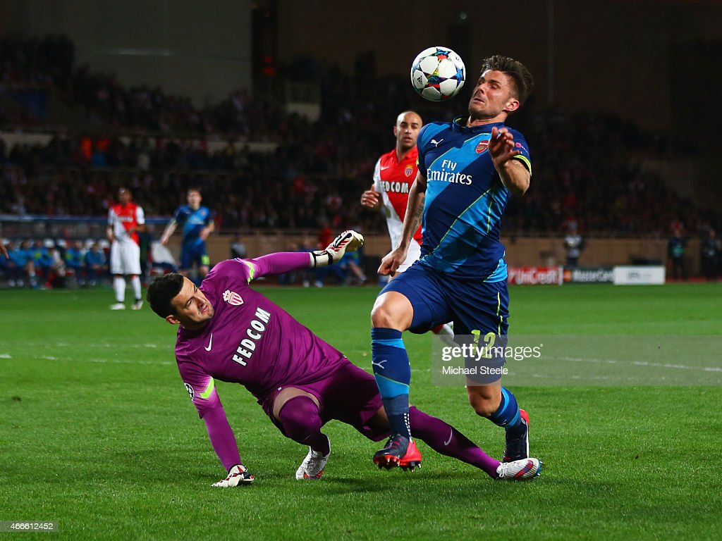 Olivier Giroud of Arsenal evades goalkeeper Danijel Subasic of Monaco before scoring their first goal during the UEFA Champions League round of 16 second leg match between AS Monaco and Arsenal at Stade Louis II on March 17, 2015 in Monaco, Monaco.