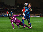 Olivier Giroud of Arsenal evades goalkeeper Danijel Subasic of Monaco before scoring their first goal during the UEFA Champions League round of 16...