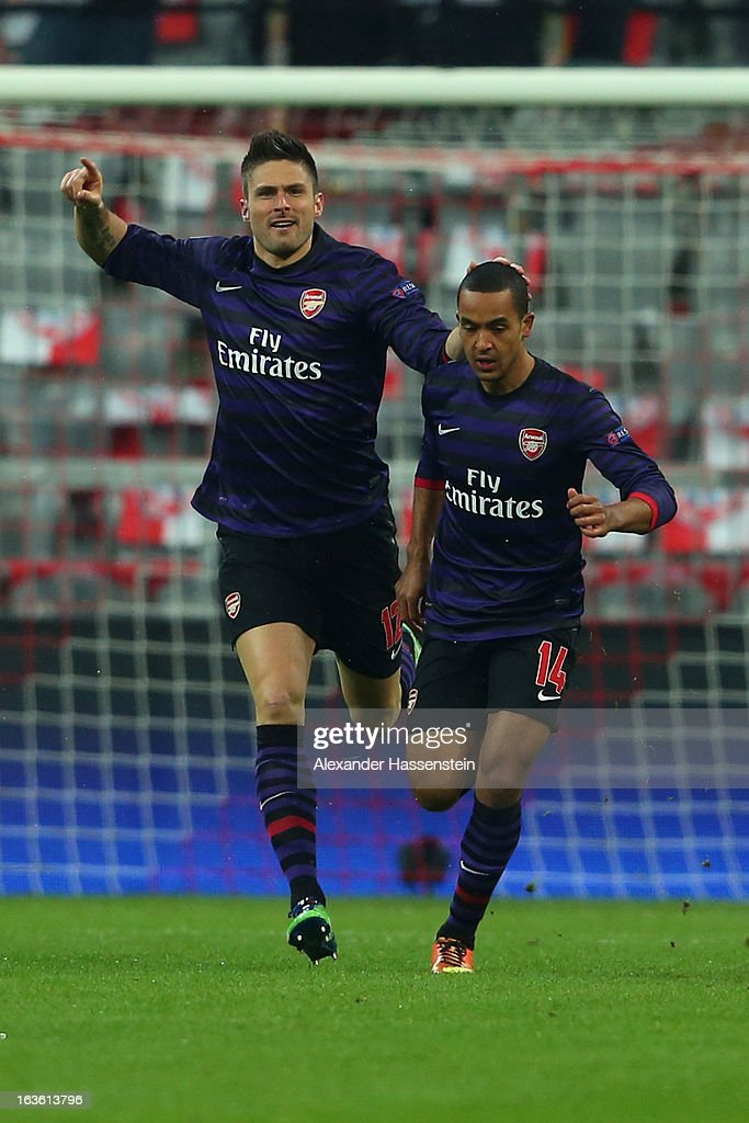 Olivier Giroud (L) of Arsenal FC celebrates scoring the opening goal with his team mate Theo Walcott during the UEFA Champions League Round of 16 second leg match between Bayern Muenchen and Arsenal at Allianz Arena on March 13, 2013 in Munich, Germany.