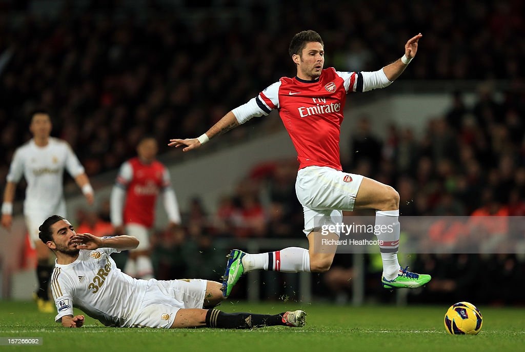 <a gi-track='captionPersonalityLinkClicked' href=/galleries/search?phrase=Olivier+Giroud&family=editorial&specificpeople=5678034 ng-click='$event.stopPropagation()'>Olivier Giroud</a> of Arsenal goes down when challenged by Chico of Swansea during the Barclays Premier League match between Arsenal and Swansea City at the Emirates Stadium on December 1, 2012 in London, England.