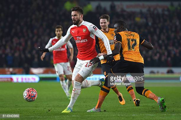 Olivier Giroud of Arsenal goes past Mohamed Diame of Hull City during the Emirates FA Cup Fifth Round Replay match between Hull City and Arsenal at...