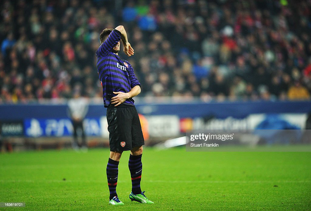 <a gi-track='captionPersonalityLinkClicked' href=/galleries/search?phrase=Olivier+Giroud&family=editorial&specificpeople=5678034 ng-click='$event.stopPropagation()'>Olivier Giroud</a> of Arsenal grimaces during the UEFA Champions League Round of 16 second leg match between Bayern Muenchen and Arsenal at Allianz Arena on March 13, 2013 in Munich, Germany.