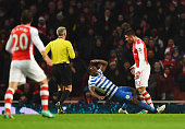 Olivier Giroud of Arsenal head butts Nedum Onuoha of QPR and is sent off during the Barclays Premier League match between Arsenal and Queens Park...