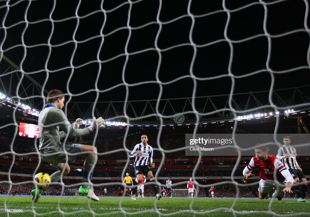 Olivier Giroud of Arsenal heads in their fifth goal past Tim Krul of Newcastle United during the Barclays Premier League match between Arsenal and Newcastle United at the Emirates Stadium on December 29, 2012 in London, England.