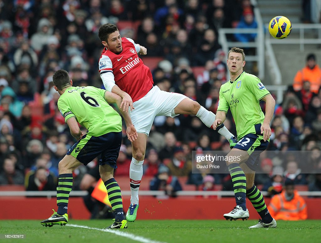 Olivier Giroud of Arsenal heads the ball under pressure from Ciaran Clark and Nathan Baker of Villa during the Barclays Premier League match between Arsenal and Aston Villa at Emirates Stadium on February 23, 2013 in London, England.