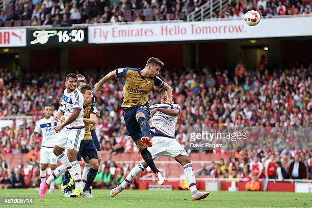 Olivier Giroud of Arsenal heads the firs goal during the Emirates Cup match between Arsenal and Olympique Lyonnais at the Emirates Stadium on July 25...