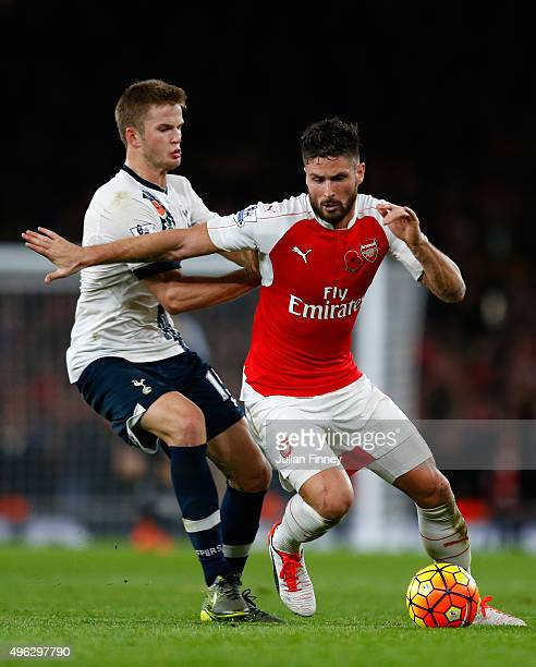 Olivier Giroud of Arsenal holds off Eric Dier of Spurs during the Barclays Premier League match between Arsenal and Tottenham Hotspur at the Emirates...