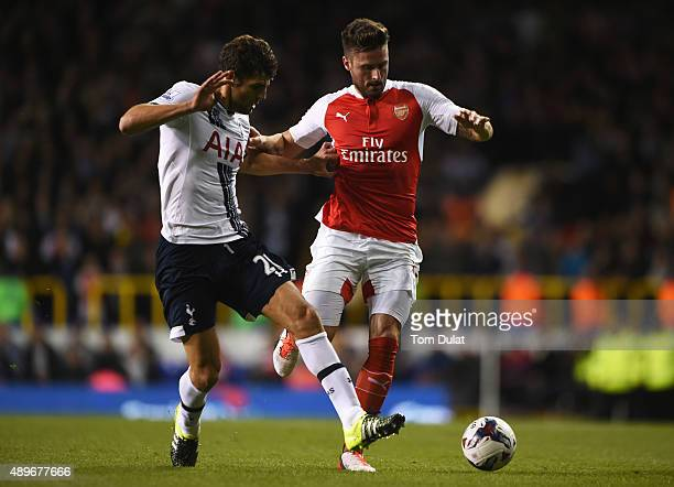 Olivier Giroud of Arsenal holds off Federico Fazio of Tottenham Hotspur during the Capital One Cup third round match between Tottenham Hotspur and...