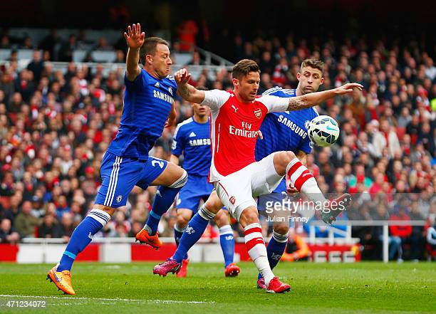 Olivier Giroud of Arsenal holds off John Terry and Gary Cahill of Chelsea during the Barclays Premier League match between Arsenal and Chelsea at...