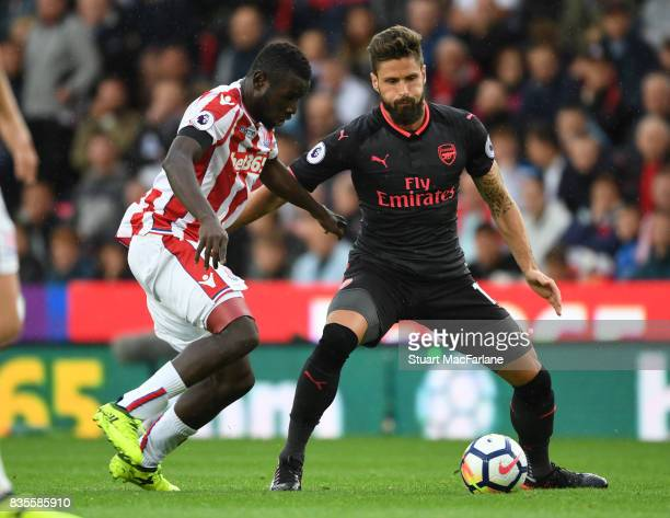 Olivier Giroud of Arsenal holds off Mame Diouf of Stoke during the Premier League match between Stoke City and Arsenal at Bet365 Stadium on August 19...