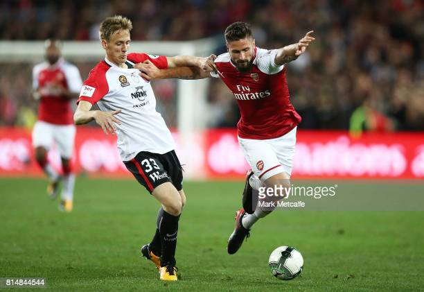 Olivier Giroud of Arsenal holds off Michael Thwaite of the Wanderers during the match between the Western Sydney Wanderers and Arsenal FC at ANZ...