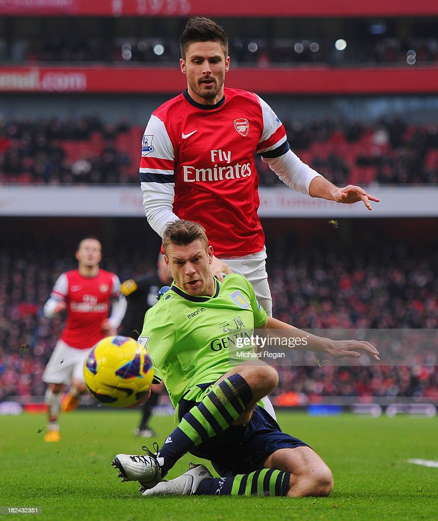 Olivier Giroud of Arsenal in action against Nathan Baker of Villa during the Barclays Premier League match between Arsenal and Aston Villa at the Emirates Stadium on February 23, 2013 in London, England.