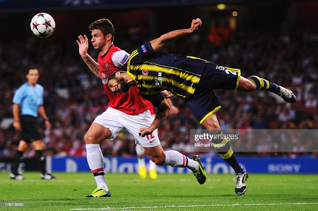 <a gi-track='captionPersonalityLinkClicked' href=/galleries/search?phrase=Olivier+Giroud&family=editorial&specificpeople=5678034 ng-click='$event.stopPropagation()'>Olivier Giroud</a> of Arsenal is challenged by Egemen Korkmaz of Fenerbahce during the UEFA Champions League Play Off Second leg match between Arsenal FC and Fenerbahce SK at Emirates Stadium on August 27, 2013 in London, England.