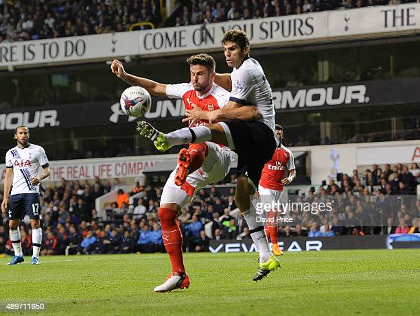 Olivier Giroud of Arsenal is challenged by Federico Fazio of Tottenham during the match between Tottenham Hotspur and Arsenal in the League Cup at...