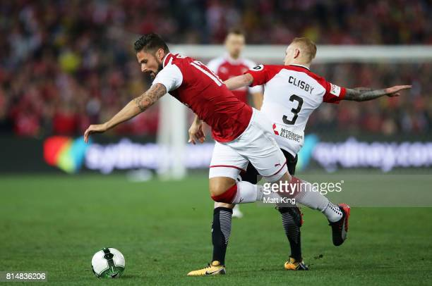 Olivier Giroud of Arsenal is challenged by Jack Clisby of the Wanderers during the match between the Western Sydney Wanderers and Arsenal FC at ANZ...