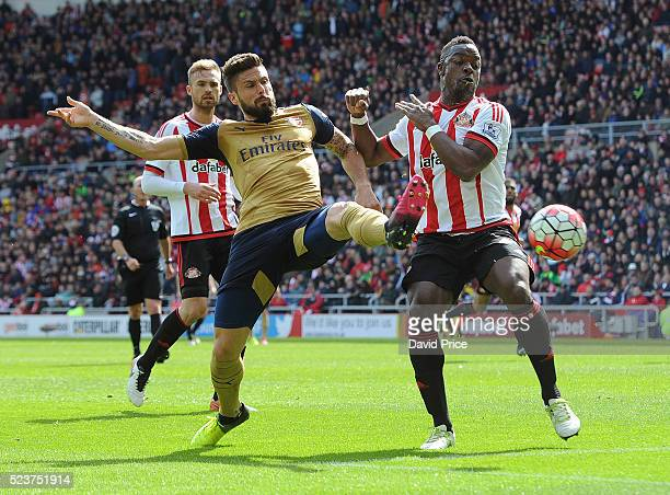 Olivier Giroud of Arsenal is challenged by Lamine Kone of Sunderland during the Barclays Premier League match between Sunderland and Arsenal at The...