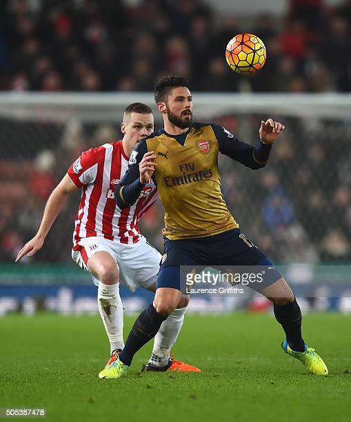 Olivier Giroud of Arsenal is closed down by Ryan Shawcross of Stoke City during the Barclays Premier League match between Stoke City and Arsenal at...