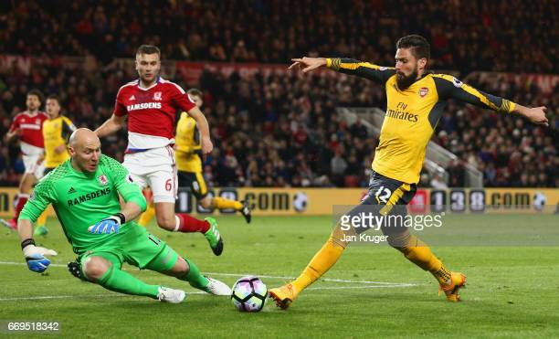 Olivier Giroud of Arsenal is faced by goalkeeper Brad Guzan of Middlesbrough during the Premier League match between Middlesbrough and Arsenal at...