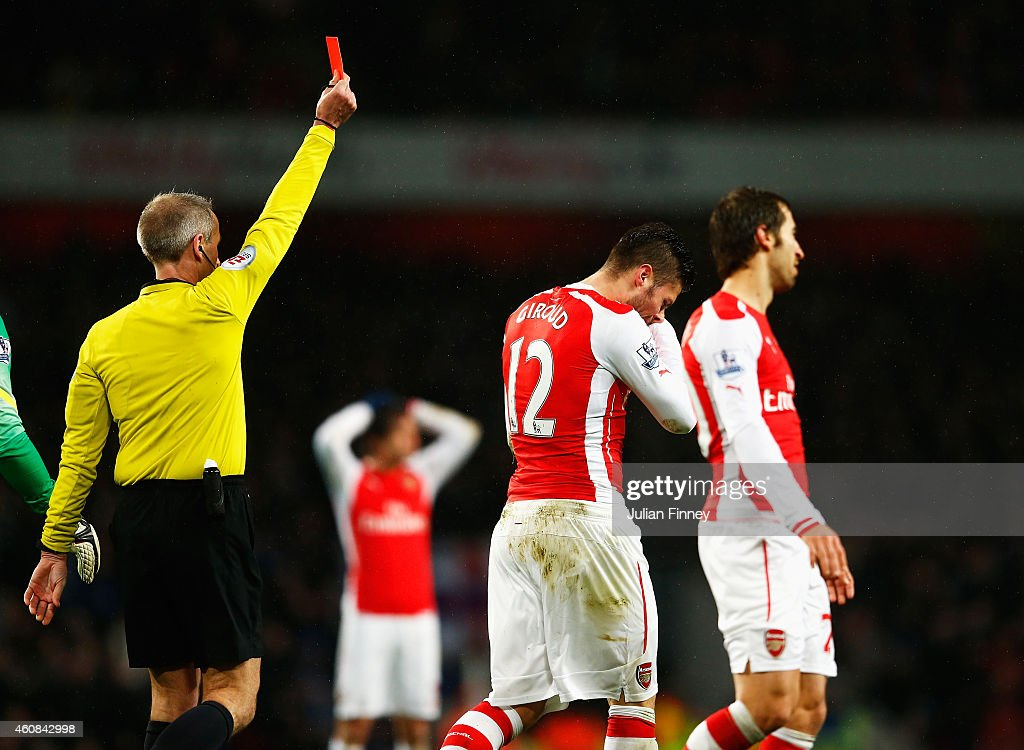 <a gi-track='captionPersonalityLinkClicked' href=/galleries/search?phrase=Olivier+Giroud&family=editorial&specificpeople=5678034 ng-click='$event.stopPropagation()'>Olivier Giroud</a> of Arsenal is sent off for a head butt on <a gi-track='captionPersonalityLinkClicked' href=/galleries/search?phrase=Nedum+Onuoha&family=editorial&specificpeople=2082844 ng-click='$event.stopPropagation()'>Nedum Onuoha</a> of QPR by referee <a gi-track='captionPersonalityLinkClicked' href=/galleries/search?phrase=Martin+Atkinson&family=editorial&specificpeople=703318 ng-click='$event.stopPropagation()'>Martin Atkinson</a> during the Barclays Premier League match between Arsenal and Queens Park Rangers at Emirates Stadium on December 26, 2014 in London, England.