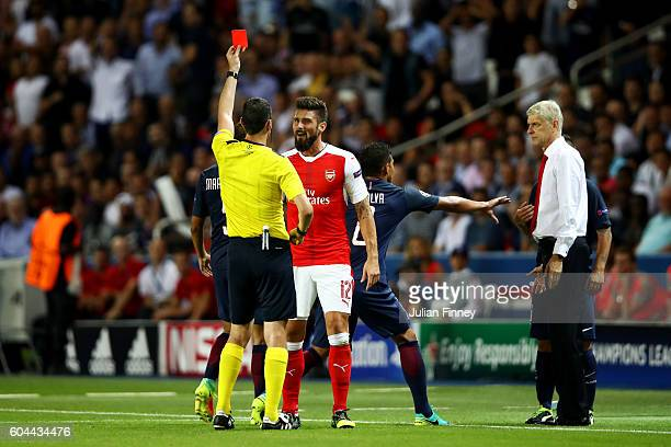 Olivier Giroud of Arsenal is shown a red card during the UEFA Champions League Group A match between Paris SaintGermain and Arsenal FC at Parc des...