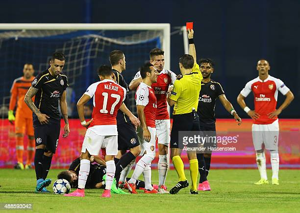 Olivier Giroud of Arsenal is shown the red card by referee Ovidiu Hategan during the UEFA Champions League Group F match between Dinamo Zagreb and...