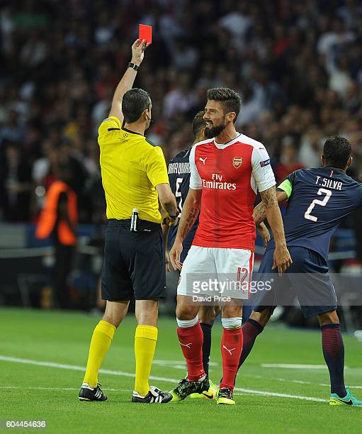 Olivier Giroud of Arsenal is shown the red card by Referee Viktor Kassai during the UEFA Champions League match between Paris SaintGermain and...